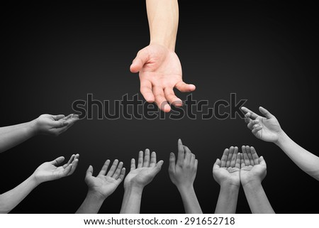 helping hand and hands praying isolated on black background , helping hand concept. - stock photo