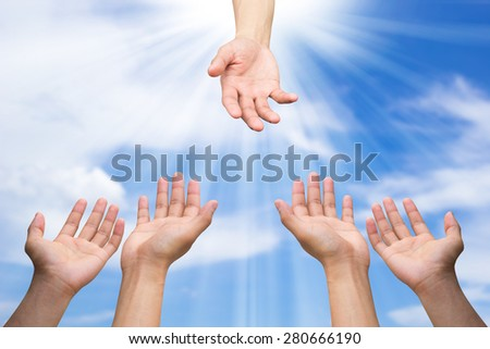 helping hand and hands praying on blurred blue sky background with ray light , helping hand concept - stock photo