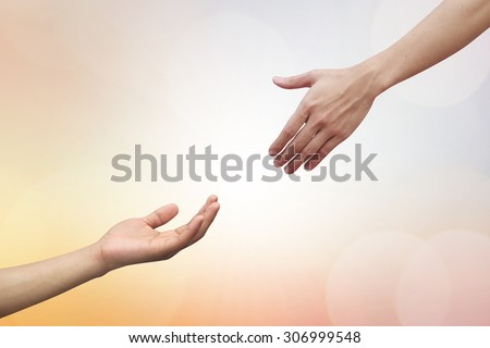 helping hand and hands praying over blurred beautiful backgrounds. helping hand concept.hand of god giving the power to human's hand - stock photo