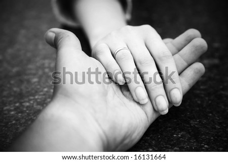 Helping hand. Black and white concept. - stock photo