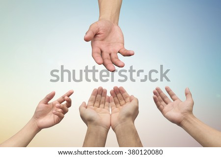 helping hand/hands praying on blurred sunrise sky background,healing concept:strong together conceptual:assistance/support:world cancer day:treatment and therapy for population conceptual ideal. - stock photo