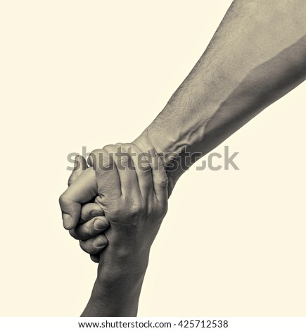 helping hand outstretched for salvation  on isolated toned background - stock photo