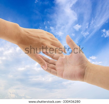 helping hands on sky background, - stock photo