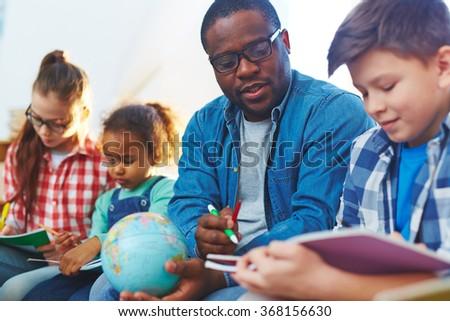 Helping schoolboy - stock photo