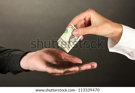 helping the homeless, on black background close-up - stock photo