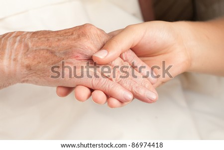 Helping the senior, holding hand - stock photo