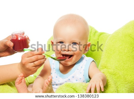 Helping to eat cute little baby boy from the spoon