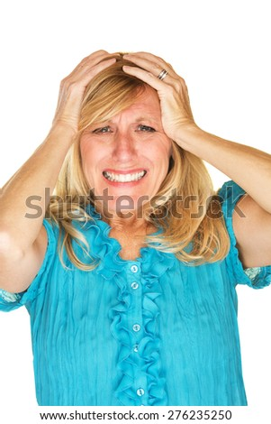 Helplessly frustrated European female holding head - stock photo