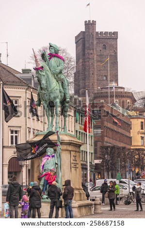 HELSINGBORG, SWEDEN - MARCH 7: Colourful decorations on the statues of Helsingborg to commemorate the swedish eurovision qualifiers taking place in the city. March 7, 2015. Helsingborg, Sweden. - stock photo