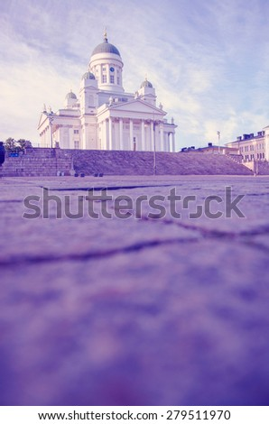Helsinki cathedral with people sitting on stairs, copyspace with instagram effect retro vintage filter - stock photo