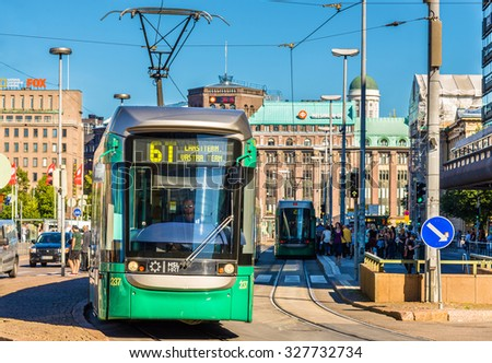 HELSINKI, FINLAND - AUGUST 16: Bombardier Variotram on August 16, 2015 in Helsinki, Finland. The Helsinki tramway system has 13 lines and 288 stops - stock photo