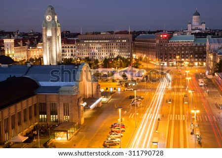HELSINKI, FINLAND - AUGUST 19, 2015: Helsinki center aerial view at night from the top floor of Sokos department store at the restaurant bar terrace.