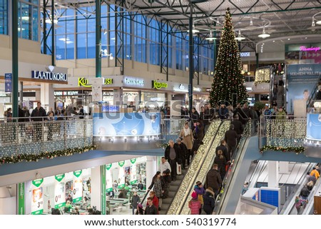 HELSINKI, FINLAND - CIRCA DEC, 2016: The second floor full of visitors is in the multi store hall of Jumbo shopping mall during Christmas eve. The Jumbo megamall is a large retailer in city