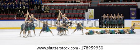 HELSINKI, FINLAND - FEBRUARY 23, 2014: Team Marigold IceUnity competes in Finnish Synchronized Skating Championships 2014  at the Helsinki Ice Hall. Team won gold. - stock photo