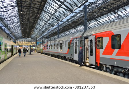 HELSINKI, FINLAND - JAN 9, 2016: Central railway station serves as point of origin for all trains in local VR commuter rail network, as well as for long-distance trains. Focus on conductor