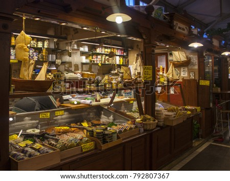 HELSINKI, FINLAND - January 3, 2018: Old Market Hall in Helsinki has served its customers since 1889. Merchants sell everything from cheese, fish, shellfish, vegetable, fruit and cakes, coffee and tea