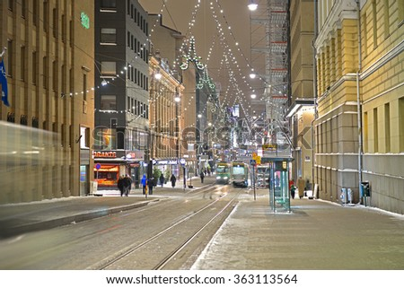 HELSINKI, FINLAND - JANUARY 10, 2016:Winter Night in Helsinki. At Christmas time, Aleksanterinkatu, street in centre, is traditionally decorated with elaborate Christmas lights
