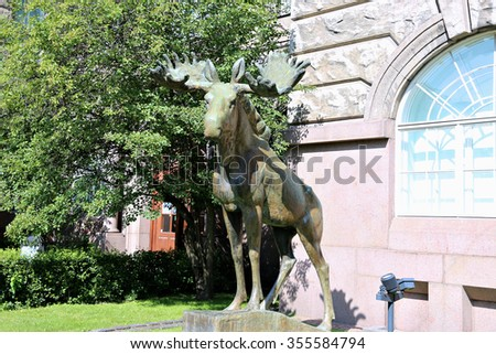 HELSINKI, FINLAND - JULY 9, 2015: Bronze sculpture of a moose in front of the Museum of Zoology in Helsinki