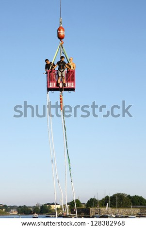 HELSINKI, FINLAND - JULY 27: Bungee jumping from a crane on July 27, 2012 in Helsinki. The height of the jump is 150 meters, the speed gained during a jump is about 120 km/h