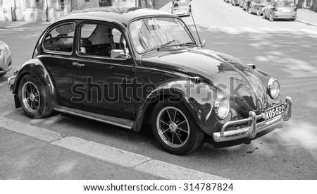 Helsinki, Finland - June 13, 2015: Early 1966 Volkswagen Beetle car is parked on the street of Helsinki - stock photo