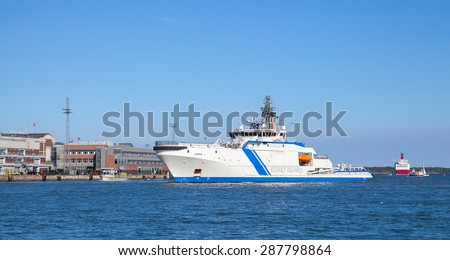 Helsinki, Finland - June 13, 2015: Finnish offshore patrol ship Turva in the port of Helsinki. The largest vessel of the fleet, first patrol boat in the world powered by liquefied natural gas - stock photo