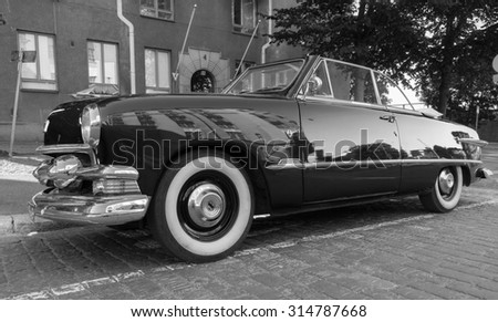 Helsinki, Finland - June 13, 2015: Old Ford Custom Deluxe Tudor car is parked on the roadside. 1951 year modification with convertible roof