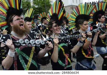 Helsinki, Finland   June 6, 2015: Traditional summer samba carnival.Teams from different cities in Finland took part in the carnival. June 6 participants parading down the center of Helsinki. - stock photo