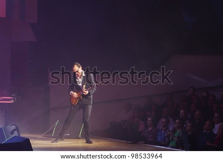 HELSINKI, FINLAND - MARCH 13: American blues rock guitarist and singer Joe Bonamassa performs at Finlandia Hall on March 13, 2012 in Helsinki, Finland. - stock photo