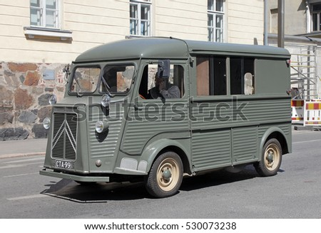 HELSINKI, FINLAND - MAY 27, 2016: Citroen H Van - light truck produced by the French car maker Citroen between 1947 and 1981. Green delivery van on Lonnrotinkatu stpeet, Helsinki, May 27, 2016