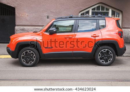 Helsinki, Finland - May 21, 2016: New shining red Jeep Renegade, side view. It is a subcompact crossover SUV  or mini SUV in Europe, produced by Jeep