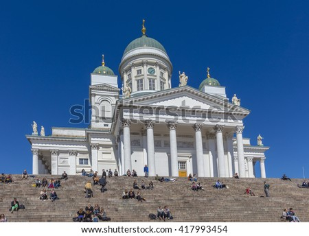 HELSINKI / FINLAND - MAY 4, 2016: People in front of White Helsinki Cathedral, the evangelical lutheran church. The church was originally built from 1830-1852.