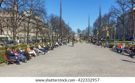 HELSINKI, FINLAND - 4 MAY 2016: people in the center of Helsinki. Helsinki is Finland's major political, educational, financial, cultural, and research center