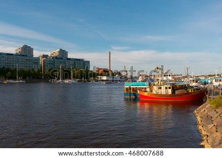 Helsinki, Finland - May 13, 2016: Siltavuorenranta, small boats harbour in central Helsinki, Finland. Sunny summer weather.