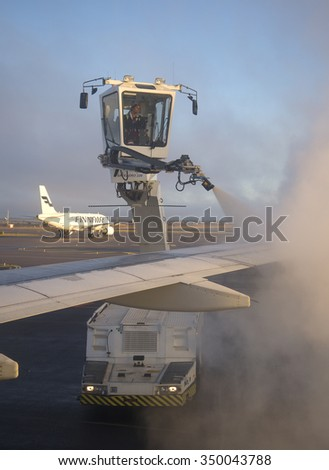 HELSINKI, FINLAND - NOVEMBER 01, 2014: Processing of aircraft wing anti-icing mixture at Helsinki airport