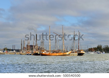 HELSINKI, FINLAND - OCT 4, 2016: Old wooden sailing ships are moored at pier named Halkolaituri