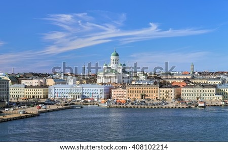 Helsinki, Finland. Scenic cityscape with Helsinki Cathedral, South Harbor, Market Square (Kauppatori) and beautiful cirrus clouds over them in the sunny spring day. - stock photo