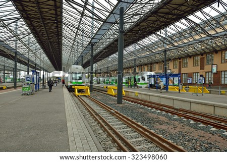 HELSINKI, FINLAND - SEPT 26, 2015: Central railway station serves as point of origin for all trains in local VR commuter rail network, as well as for large proportion of long-distance trains