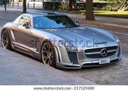 HELSINKI, FINLAND - SEPTEMBER 13, 2014: Silver metallic Mercedes-Benz SLS roadster tuned by FAB Design stands parked on a street side of Helsinki - stock photo