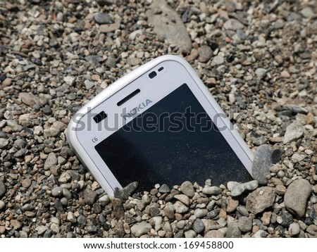 HELSINKI, NORWAY -Â?Â? JUNE 24, 2012: Nokia bogged down, sinking as it continues to experience financial difficulties in an ever more competitive mobile communication market. - stock photo