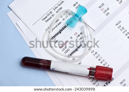 Hematology A1C report with butterfly catheter and blood collection tube. - stock photo