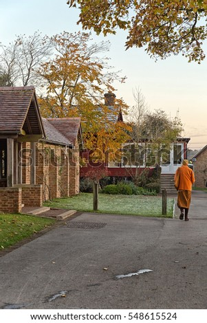 Hemel Hempstead, England - November 2016: Monk walking around the Amaravati Buddhist Monastery. The monastery is inspired by the Thai Forest Tradition and the teachings of the late Ajahn Chah