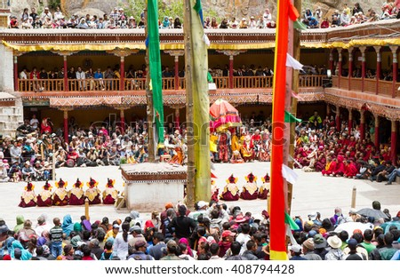 Hemis, India - June 29: courtyard of the monastery during the Cham Dance Festival of Tibetan buddhism, full of spectators and performers on June 29, 2012 in Hemis monastery, India. - stock photo