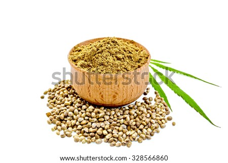 Hemp flour in a bowl, beans and green leaf of hemp isolated on white background - stock photo