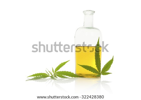 Hemp oil and cannabis leaf isolated on white background. Healthy cannabis oil.  - stock photo