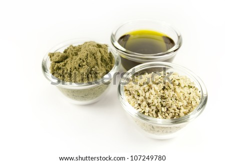 hemp products: oil, powder, seeds - stock photo