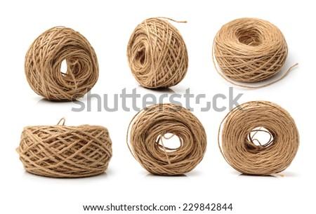 Hemp rope on white background - stock photo