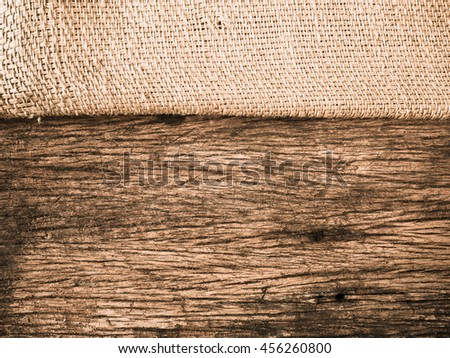 hemp sack texture on old wood texture for background design or web banner - stock photo
