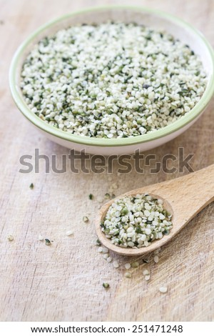 Hemp seeds close up with a spoon - stock photo