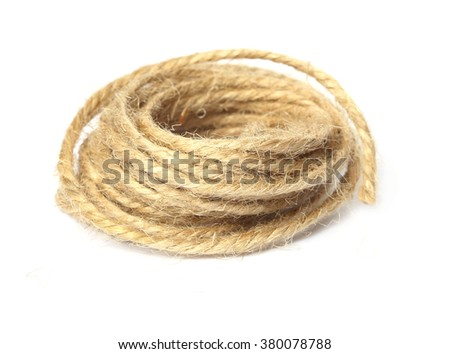 Hemp three strand rope coiled in a circluar pattern isolated against a white background. - stock photo