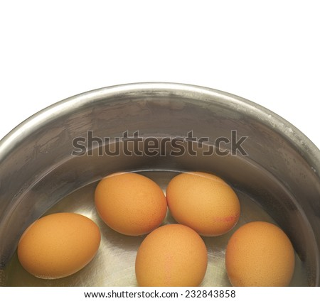 hen eggs  in metal pot  isolated on white background - stock photo